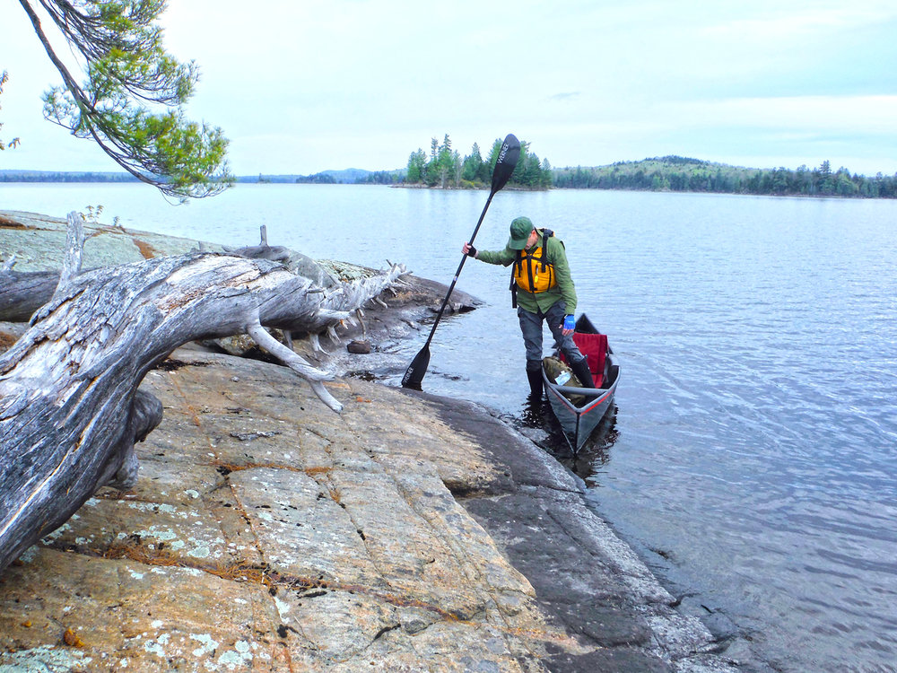 Stopping for a break on a rocky island on Little Tupper Lake.   Rich Macha