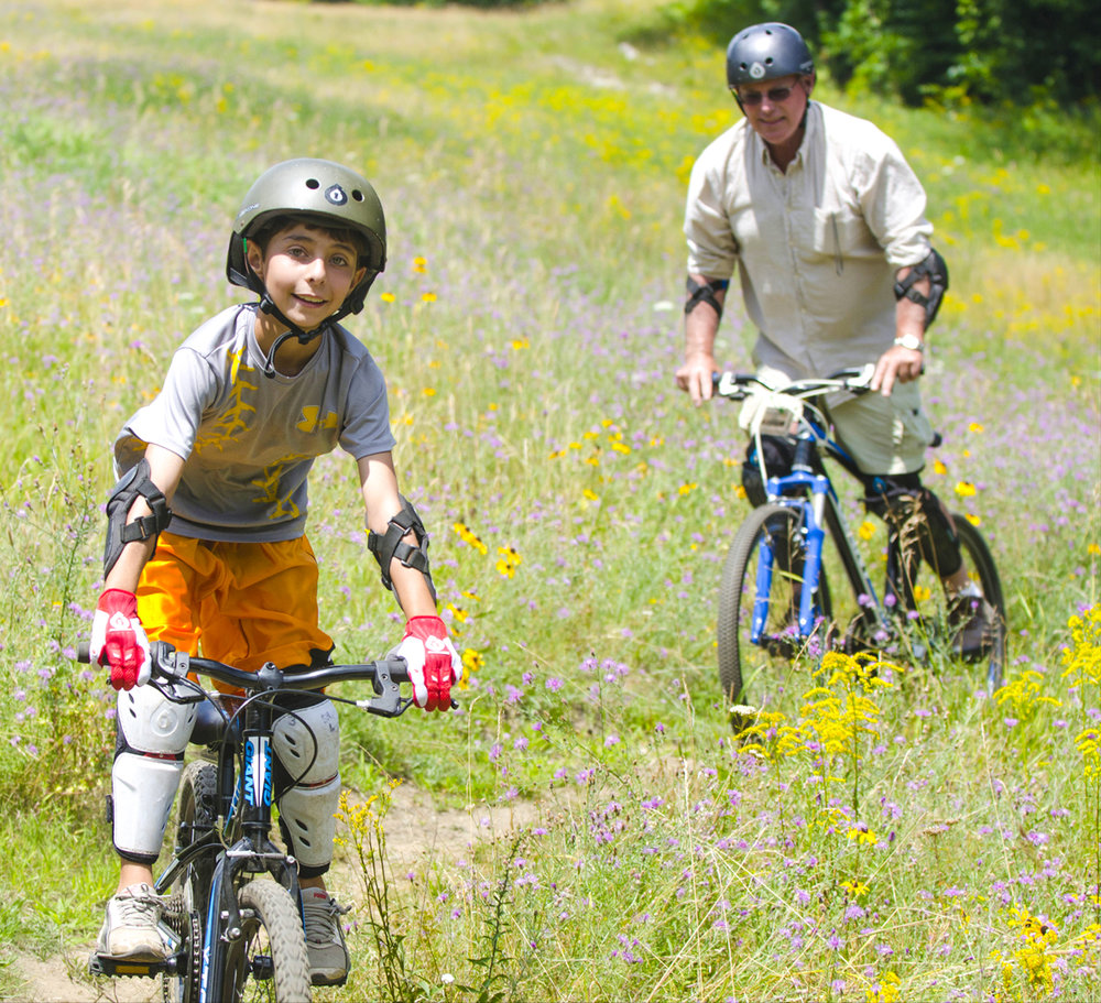 Great fun for families as this grandfather rides down one of the easier trails with his grandson. Jake Sporn
