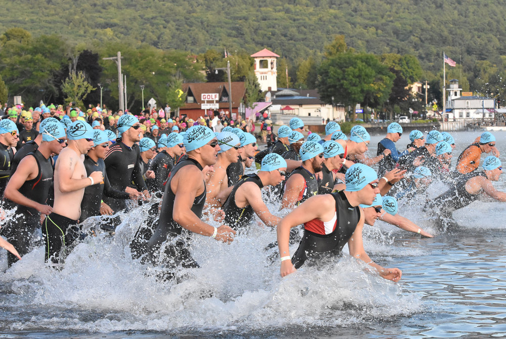 An Olympic swim wave starts at the 2016 Lake George Triathlon Festival. Pat Hendrick Photography