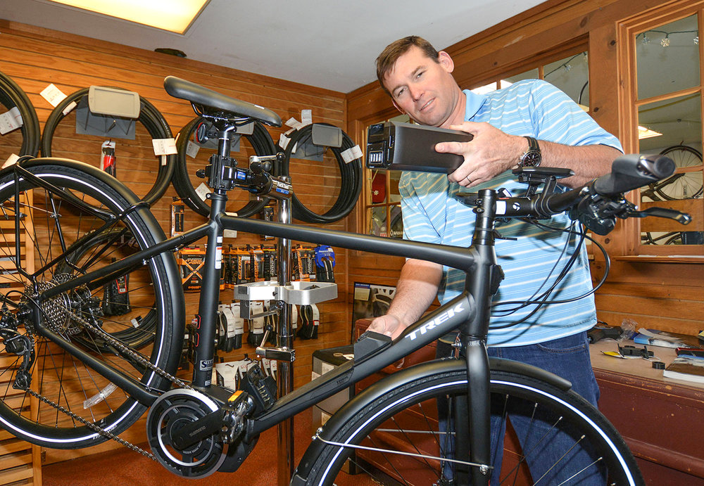 Co-owner of Steiner's Ski & Bike Garrick Dardani with one of the Trek e-bike models they carry. Dave Kraus