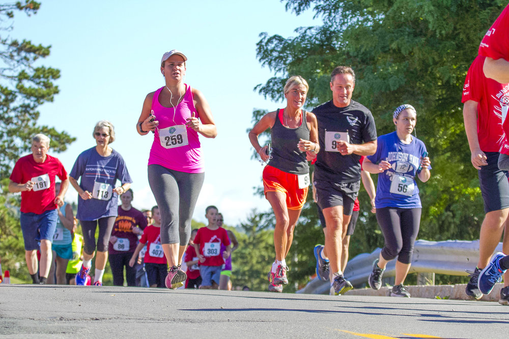 "2016 FAM 5K ""Fund"" runners near the first mile on the SUNY Cobleskill campus. The 2017 run/walk is on September 23. Joe Mulone Photography"