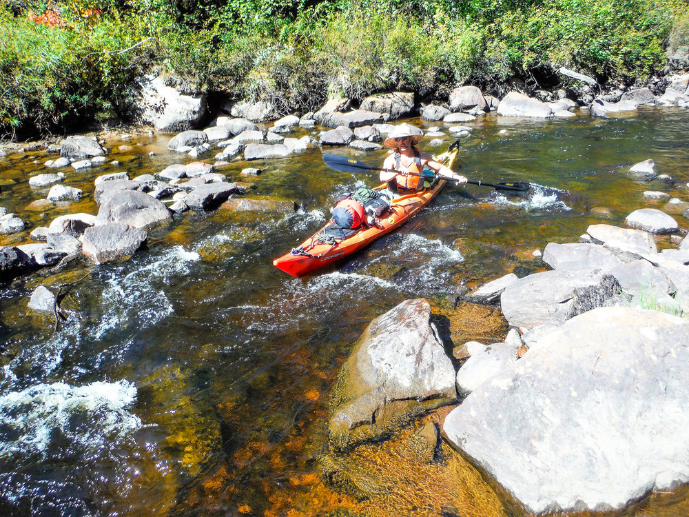 Paddling down Crooked Rapids.     Rich Macha