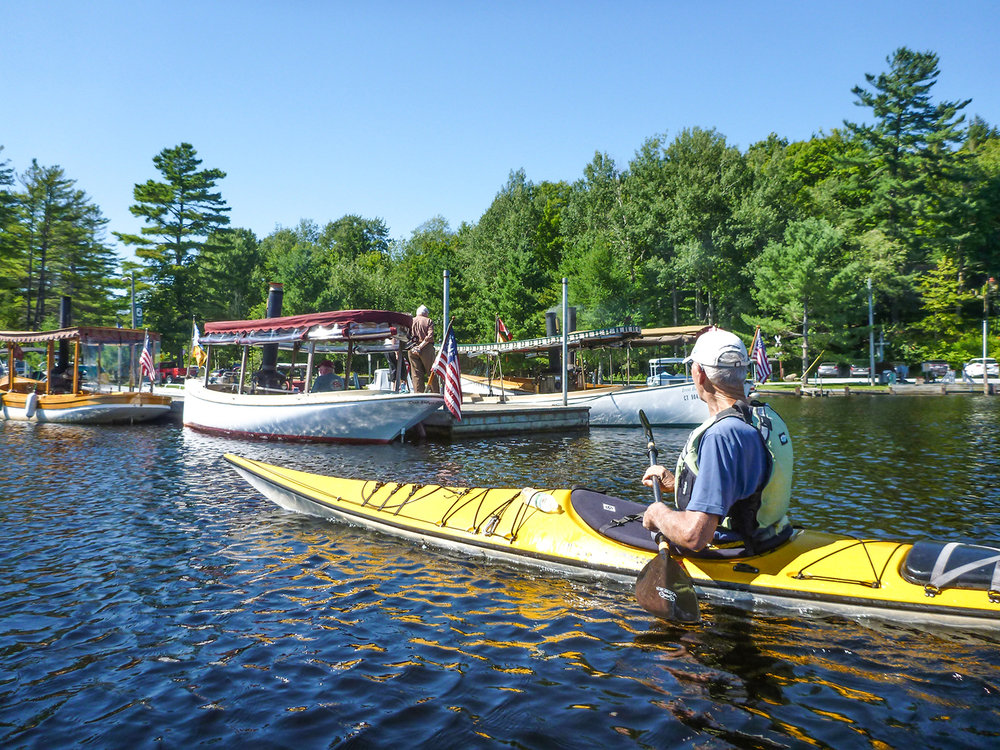 Roy Wood of Saugerties checks out the steam launches docked at Raquette Lake Village.   Alan Mapes