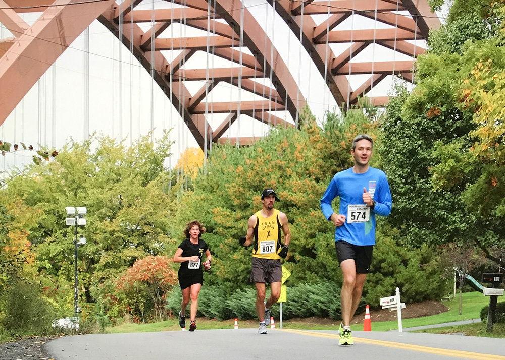 Runners in the marathon approach the halfway mark in Colonie near the Twin Bridges.  Bill Meehan