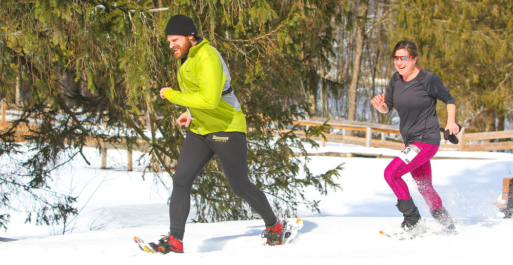 Matthew Miczek and Jennifer Ferriss, both of Saratoga Springs, enjoying the snow at the 2017 Camp Saratoga Snowshoe Race at Wilton Wildlife Preserve & Park. Brian Teague