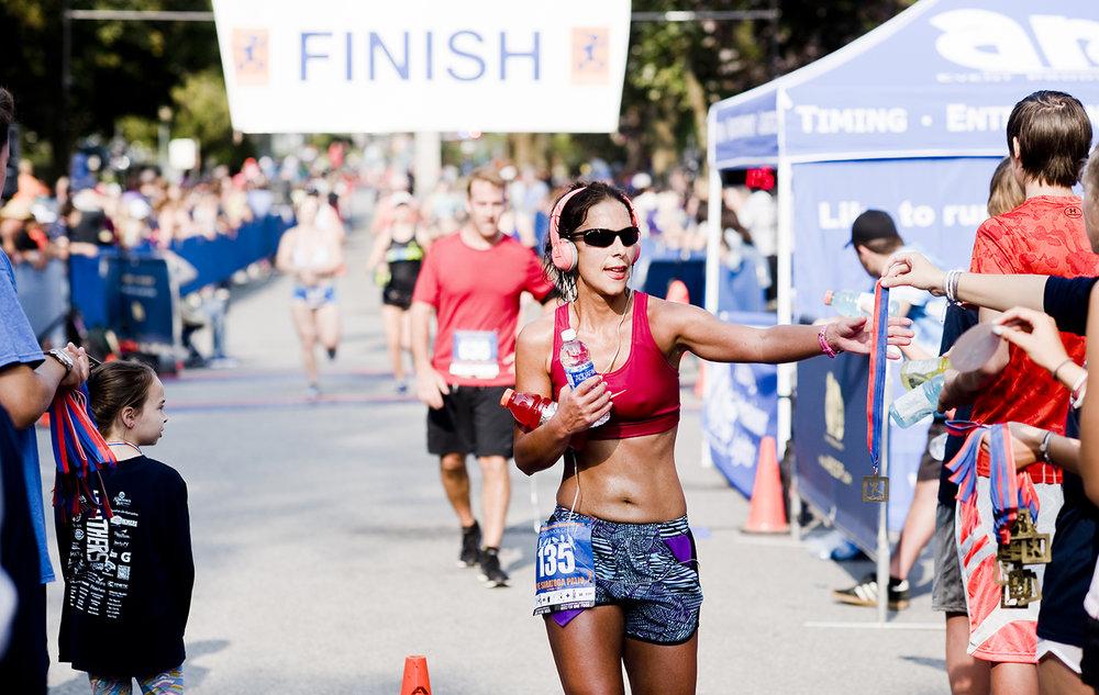 Emilie Castiglione of Glenmont finishing the 2017 Saratoga Palio Half Marathon.  Jean D'Andrea Griffin