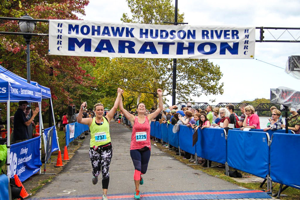 Dorian Longton and Stacey Tourtellot of Ballston Spa finish the 2017 Mohawk Hudson River Marathon.  HMRRC