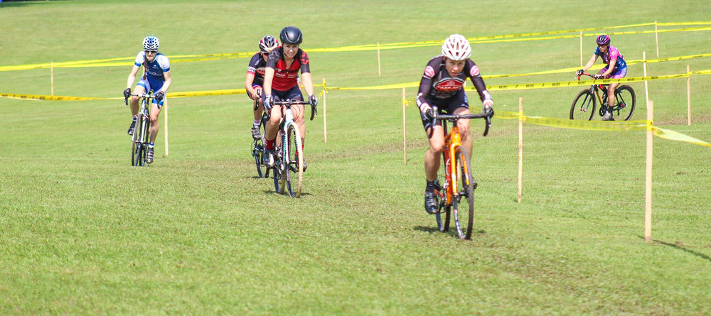 The Women's Elite field powers through the energy sapping grass section at the 2017 Kirkland CX race in Central NY.   NYCROSS