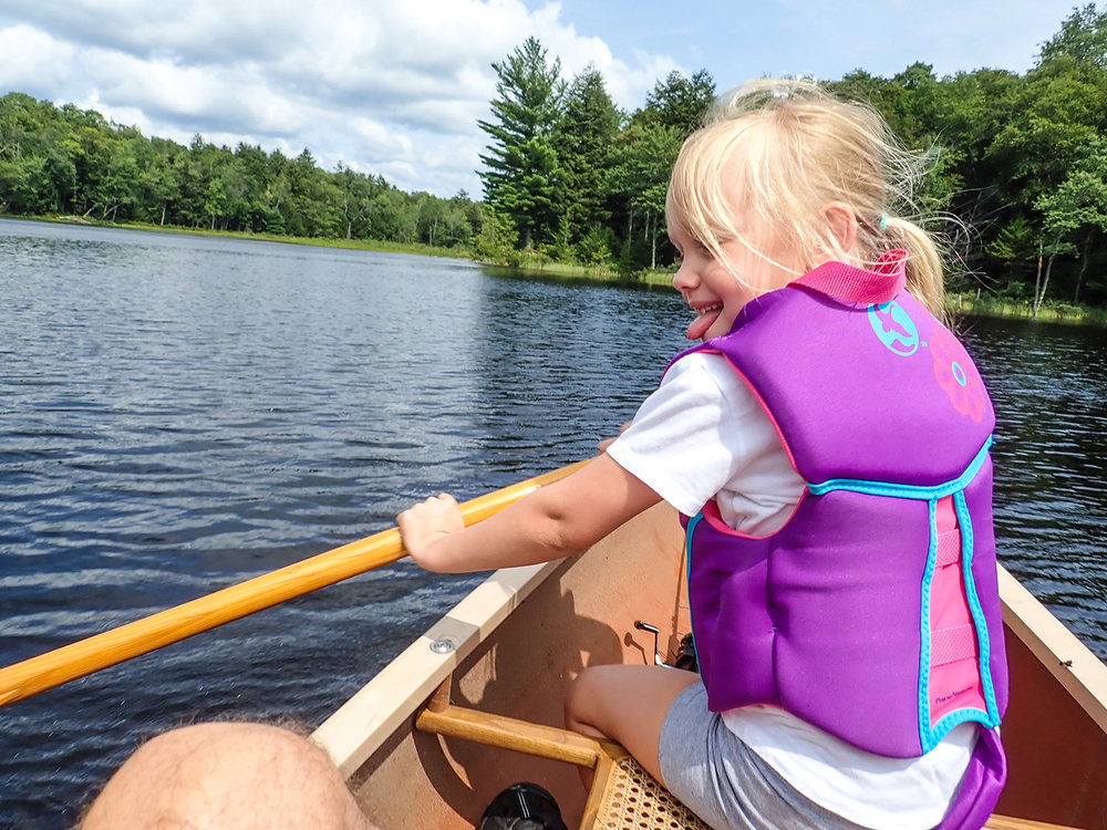 Nora makes waves from the front seat.   Alan Mapes