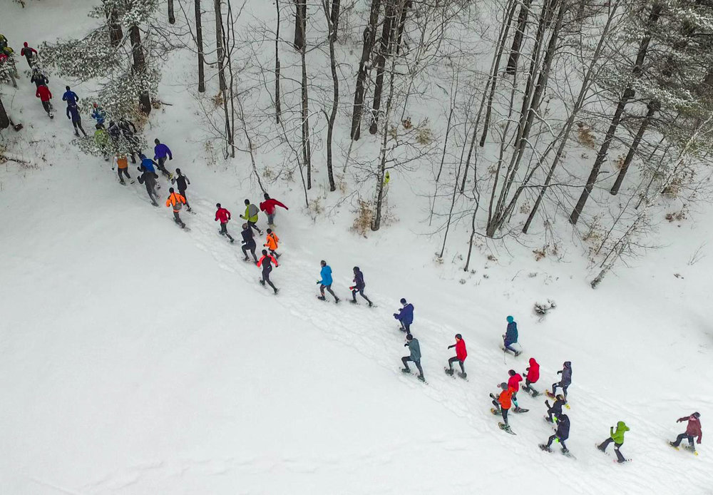 Drone's eye view of 2018 Stone Bridge Caveman 6K Snowshoe Race.    Natural Stone Bridge and Caves