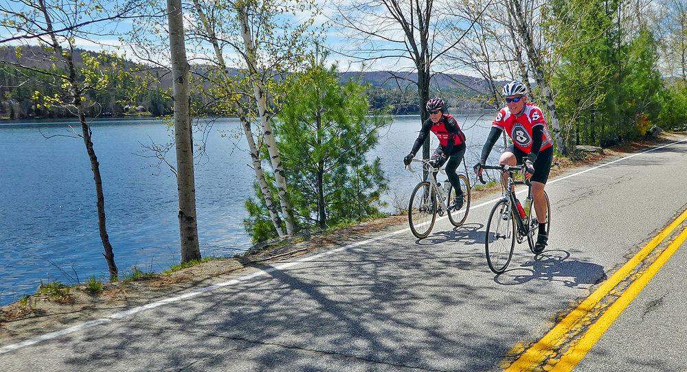 Riding from The Hub Café, Bar & Bike Shop, along Brant Lake.   Dave Kraus/   krausgrafik.com