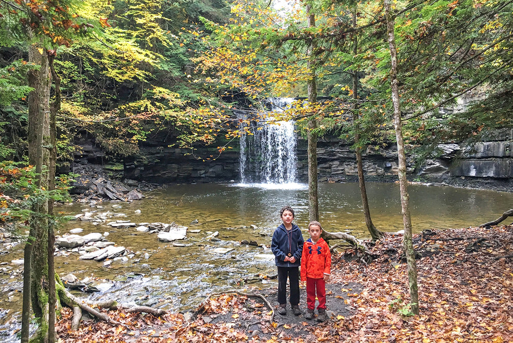 Conor and Theo enjoy exploring near the waterfall at Christman Sanctuary.