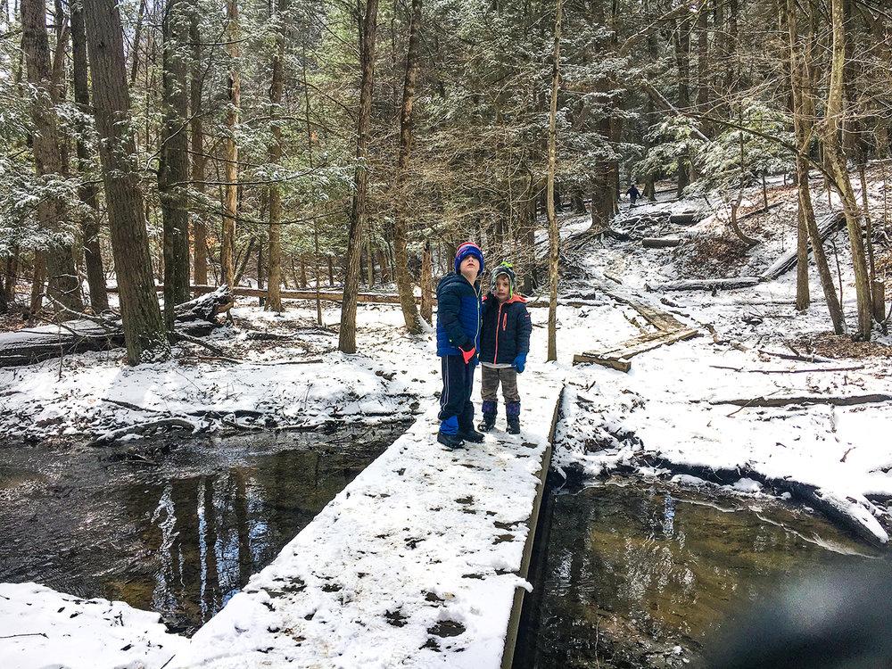 Conor and Theo enjoying a break on a bridge at Lisha Kill Preserve.