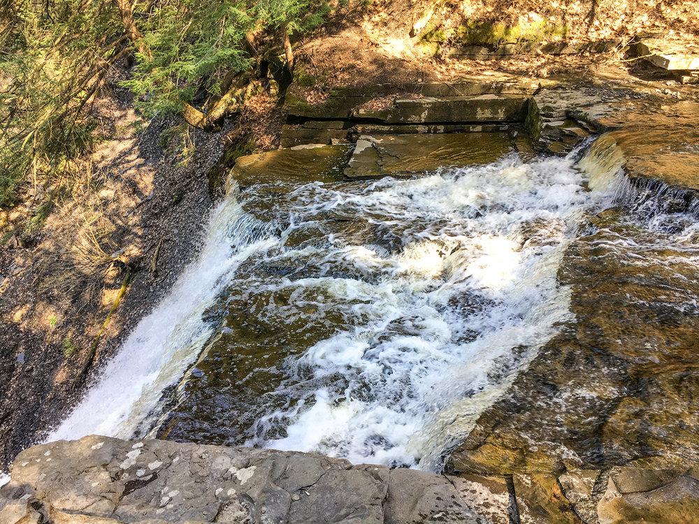 Enjoying a great falls view at Plotter Kill Preserve on a summer day.