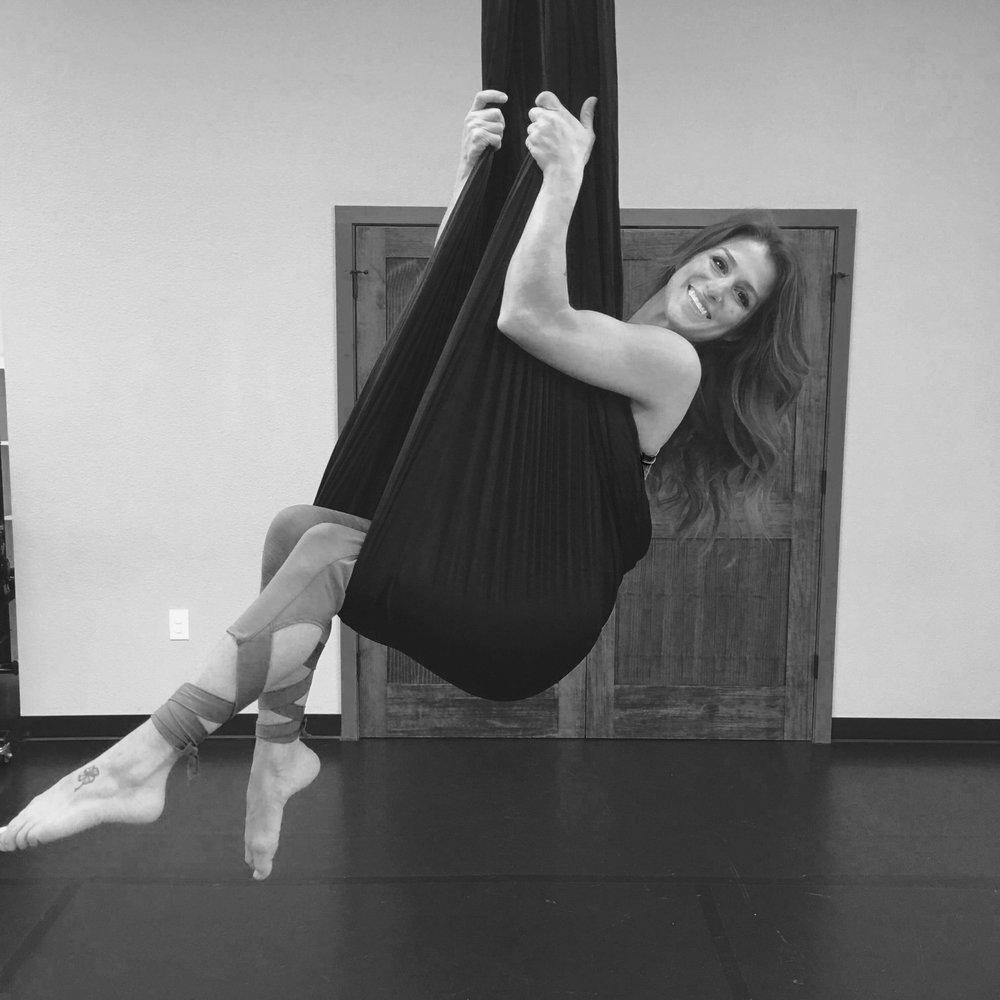 Erica - Erica is a certified aerial instructor, registered yoga instructor 200 ERYT, has years of gymnastics training, and happens to be one of the kindest people you'll ever meet!To schedule or inquire about a private class, workshop, or party with Erica please click the button below.