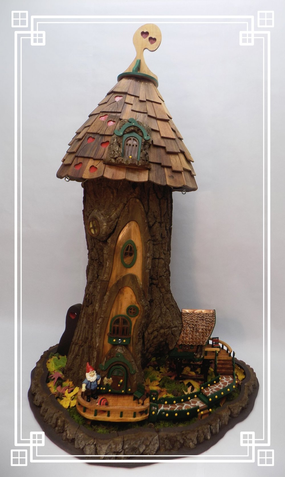 "Gnome Home Tree - six feet tall and four feet wide at the base. The Gnome Tree Home has 19 LED mini sparkling lights installed in the interior. The two tree sections are joined together while on display.   ""Magic""   happens when you PEEK inside through the many windows."