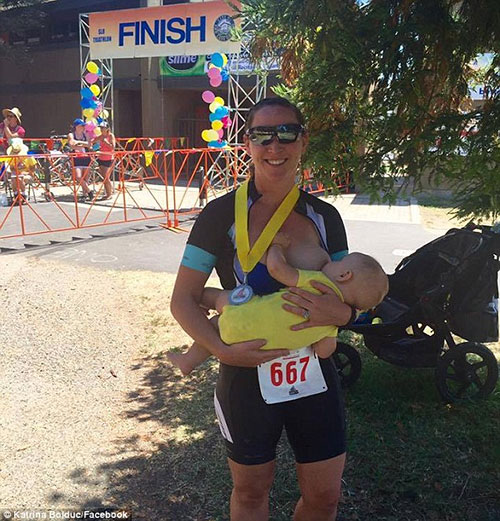 Katrina Bolduc breastfeeds her son, Grayson, after completing her first postpartum sprint triathlon. Image Credit: Katrina Bolduc/Facebook
