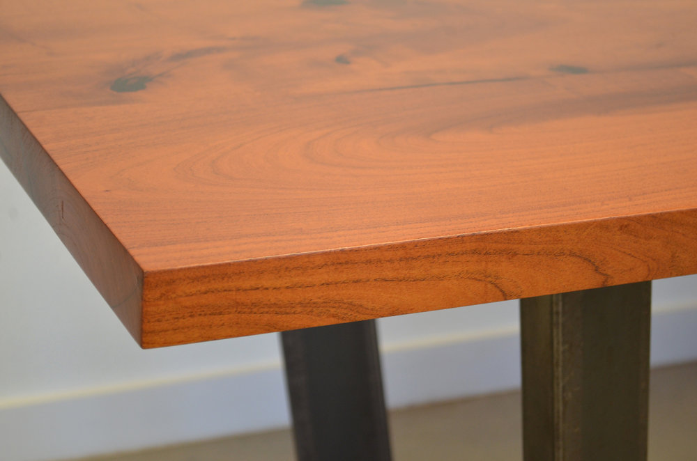 Close up edge of mesquite dining table