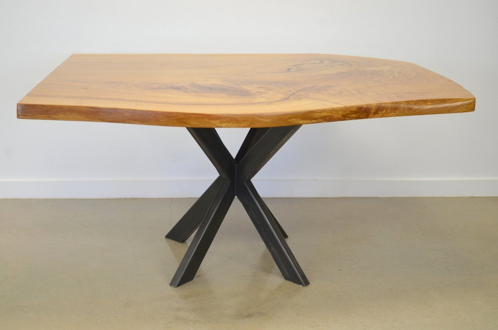 Live edge dining table featuring white oak natural wood. Wood and metal furniture designs, quad base dining table, natural wood furniture, clearance furniture Austin.