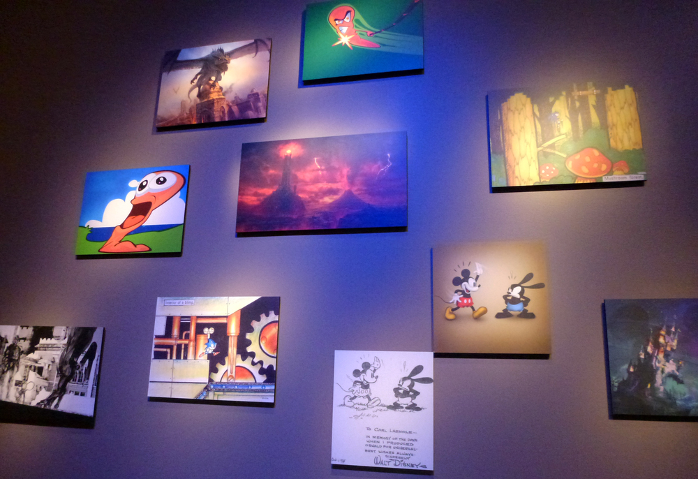 Concept art from various video games hung up on the walls of The Art of Video Games.