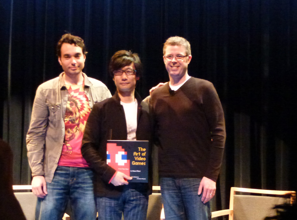 After the panel, Kojima poses with curator Melissinos holding a signed copy of The Art of Video Games. The book is the official companion to the exhibit and was signed by all developers over the weekend.