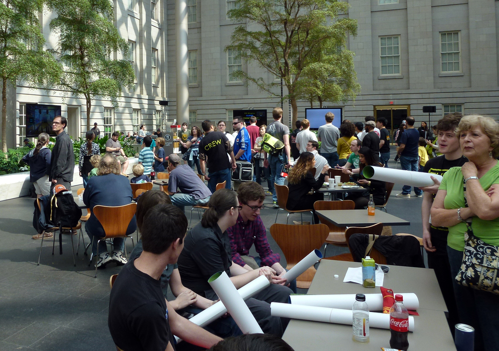 Attendees gather in the courtyard and relax between panels by playing games and chatting with developers.