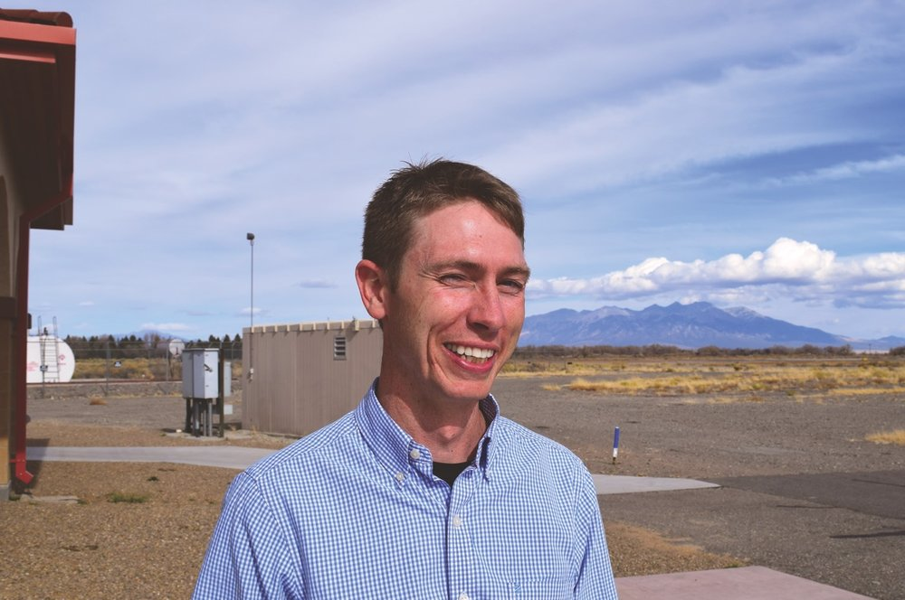 San Luis Valley Regional Airport Manager Dustin Allinger, 36, stands outside of the terminal. He's been working at airports for 11 years.