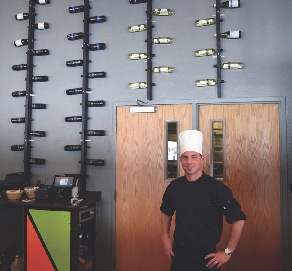 Dante Tripi, 35, stands inside Rhybax Kitchen, his new restaurant at Cattails Golf Course.The roughly 3,200 square foot dining area of Rhybax Kitchen can seat 134 guests for lunch, dinner and Sunday brunch. After the winter the patio will be able to seat more.