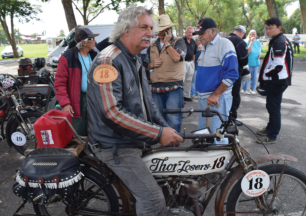 "Doug Feinsod of Santa Crus, California demonstrates his 1913 Thor motorcycle during a lunch break of the Motorcycle Cannonball Run at Cole Park in Alamosa on Sept 20, 2016. The event is a stamina ride with 95 entries of pre-1916 motorcycles. Feinsod is one of three racers to compete in it all four years. ""It's humbling to see everyone come out,"" Feinsod said."