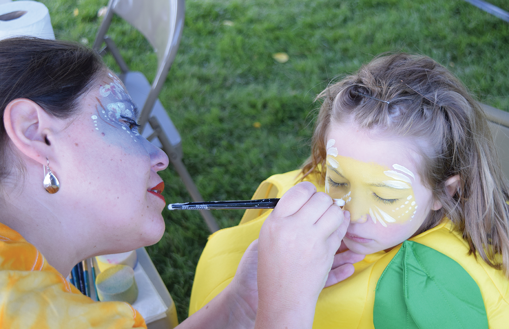 Callie Adams paints the face of her 6-year-old daughter Cate, dressed as a lemon, at the second annual Mellow Yellow Lemon Run on Labor Day, 2016 in Cole Park. Adams' sister Casey Martinez was diagnosed with cancer earlier in the year. The Sunshine Christian School sponsored event raised an estimated $6,000. About half of the pro- ceeds will go to Peyton Sanchez so that he may continue to receive cancer treatment.
