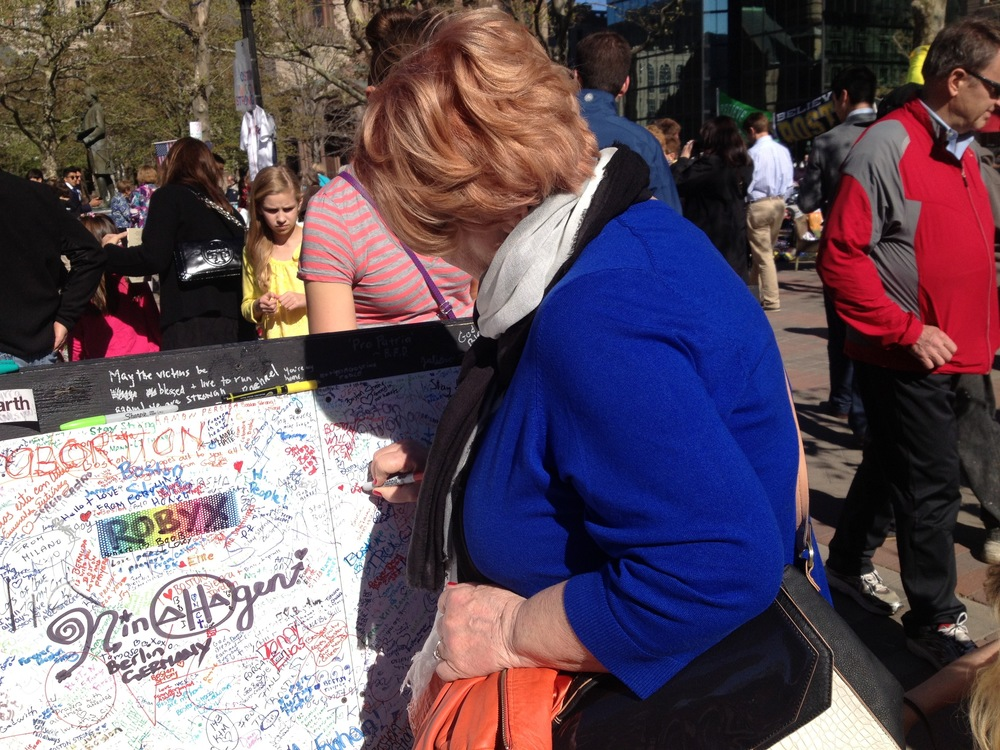 Mom at the make-shift memorial just weeks after the marathon 2013