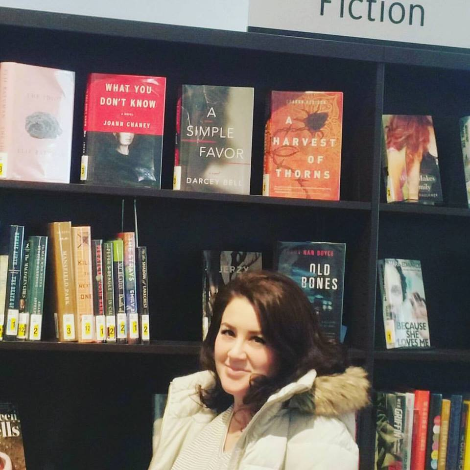Me at the Avon Library, posing under WHAT YOU DON'T KNOW. (I ended up sneaking into a corner with the book and writing a little message in it. AND I FELT LIKE A CRIMINAL.)