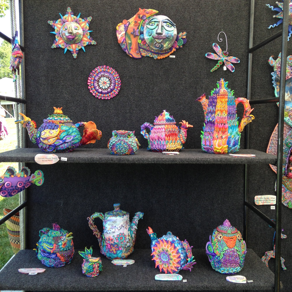 Shelves of teapot sculptures at the beginning of the summer.
