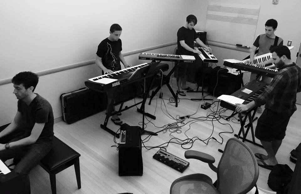 Rehearsing original music with a five-keyboard ensemble