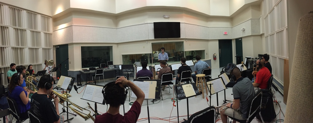 Conducting a brass recording session for a film scoring project in Miami, FL