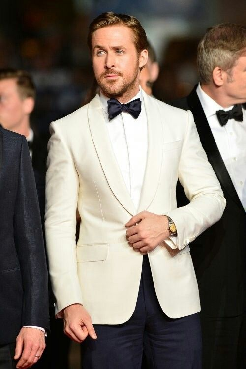 The Groom - Dress your man in head to toe class with a white tux jacket, black bow tie, and black pants. (Don't we all wish Ryan Gosling was the groom?)