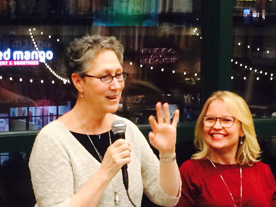 Amy Ferris, left, speaks at a Shades of Blue event along with Hollye Dexter, one of the book's contributors.