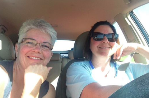 Trina and Stephanie take time out for a selfie while stuck in traffic