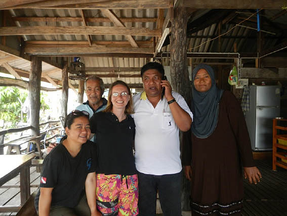 With the family of Bang Lee at Koh Pu.  Lindsay Aylesworth/Project Seahorse