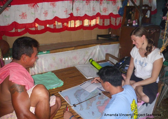 Researcher Jenny Selgrath mapping a rare coral reef with local fishers.  Amanda Vincent/Project Seahorse