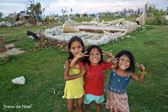 Kids posing and playing in Madridejos, an area hit very hard by Typhoon Yolanda.