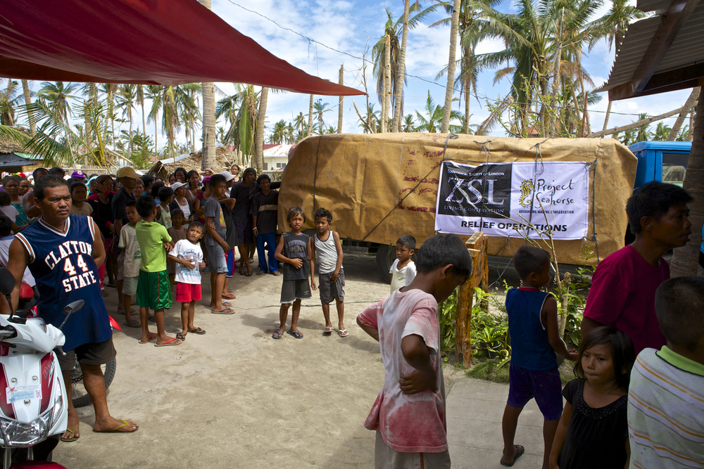 People gathering around the ZSL/Project Seahorse relief truck in Bantayan Island. Photo by Steve de Neef