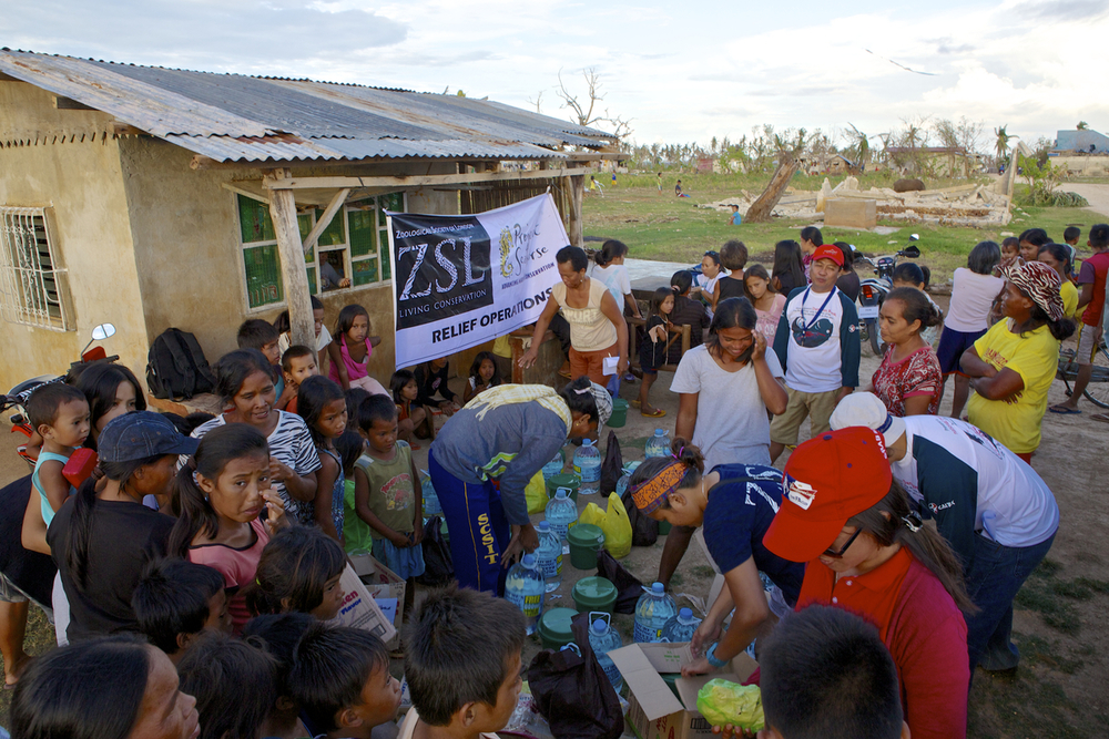 Distributing emergency supplies in Dunganon Bank, Bantayan. Photo by Steve de Neef