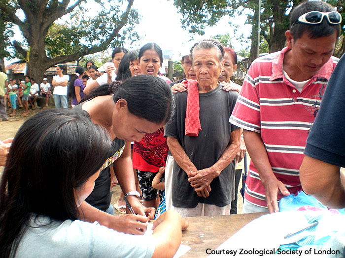 Registration for post-storm disaster relief assistance. Panay, Philippines.  Photo courtesy of ZSL