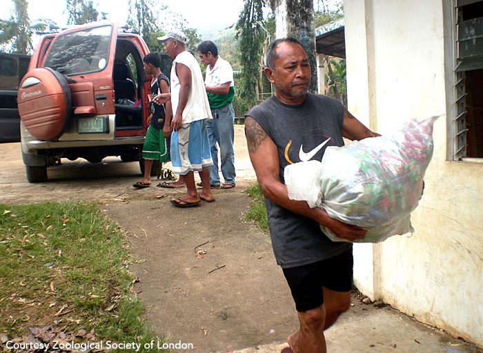 A barangay captain (village head) helps with the relief effort. Panay, Philippines.  Photo courtesy of ZSL