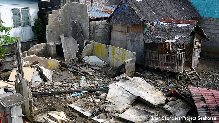 Houses knocked down by last month's earthquake.  Photo: Brian Saunders/Project Seahorse