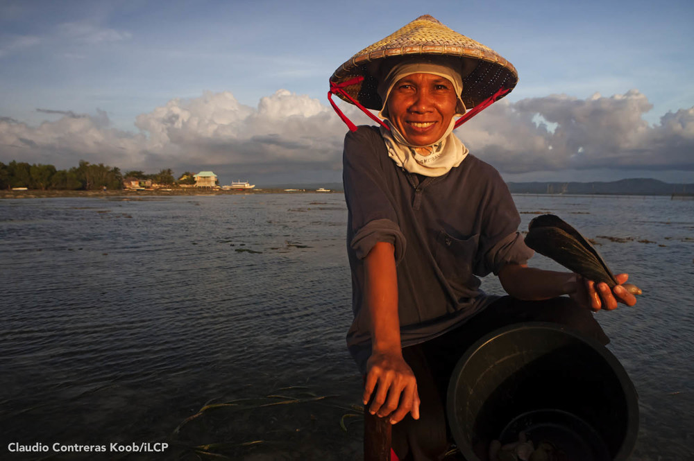 A resident of Batasan Island, Danajon Bank takes a break from collecting shells.  Claudio Contreras Koob/iLCP