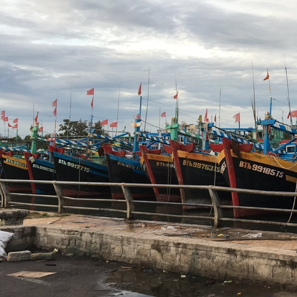 Trawl boats lined up along the harbor of Phan Thiet,  Binh Thuan Province. Photo by Do Huu Hoang.
