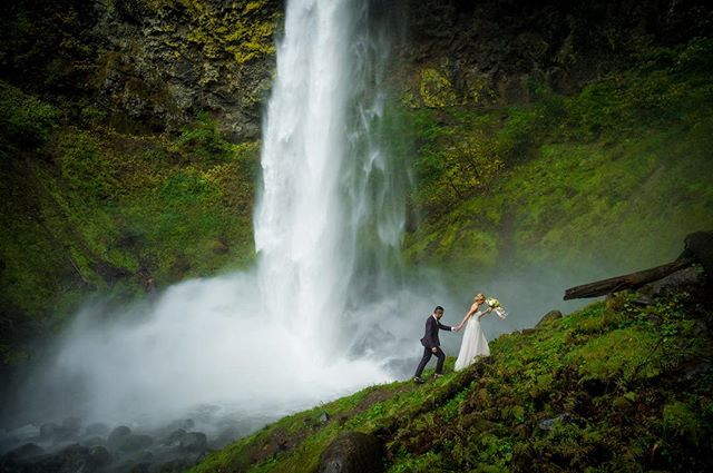 A deluge of rain had poured down for days in the Columbia River Gorge before Daisy and Andy arrived from California to get married at Oneonta Falls.  I felt apologetic as I met them in the parking lot, pointing at the overflowing river and saying we could try to get back there, but worried that it would be flooded, and offered an alternative location.  Undaunted, they waded through the swollen creek, bouquet and dress and suit in-hand, and we all carefully climbed up onto the log jam.  Beyond was a huge, deep drop of water, so they decided to get married right there on the log jam.  As they changed, their guitarist took out his instrument and began to play, the water rushed all around us, and the mossy walls of the slot canyon towered above us.  I remember standing there, smiling, thinking about what a crazy/terrifying/magical/adventurous day this was.  Soon, Daisy and Andy were married (all of us standing on our very own log), we made our way safely back to the car.  Off we went to Elowah Falls for more photos and hiking, a misty skirt thundering down around the base of the waterfall.  This was one of the best days, a day that I'll never forget, with two wonderful people who refused to let some rain get in their way. #elopeinoregon #waterfallwedding #aralaniphotography