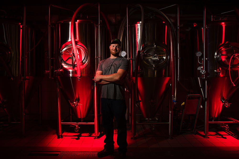 John McGrady, 28 of Akron, poses for a portrait in front of the fermentation tanks as the new head brewmaster at Butcher and the Brewer in downtown Cleveland on June 29, 2016. (Dustin Franz/The Washington Post)